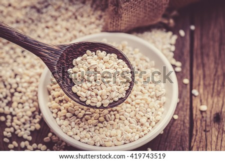 barley beans pour from sack on wood background #419743519
