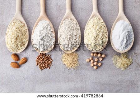 Wooden spoons of various gluten free flour (almond flour, amaranth seeds flour, buckwheat flour, rice flour, chick peas flour) from top view Royalty-Free Stock Photo #419782864
