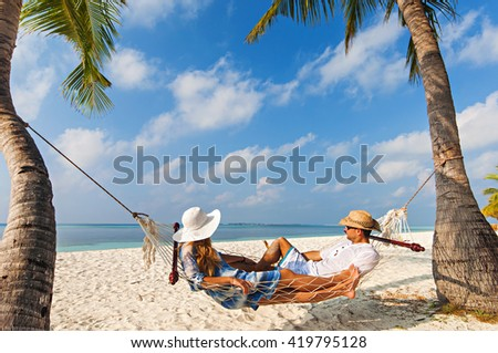 Relaxing time in Kuredu, Maldives on hammock with beach and sea in the background #419795128