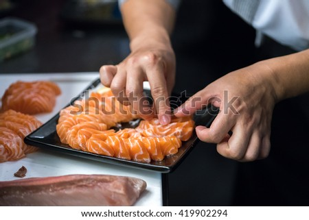 chef arrange salmon sashimi #419902294