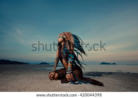 indian woman outdoors at sunset. native american style. Background with free text space
