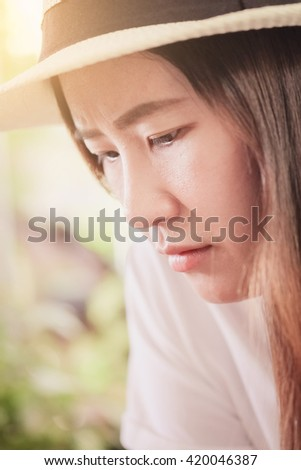Close-up of face of young asian woman wearing hat lifestyle portrait #420046387