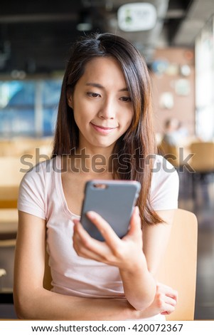 Woman using cellphone inside cafe #420072367