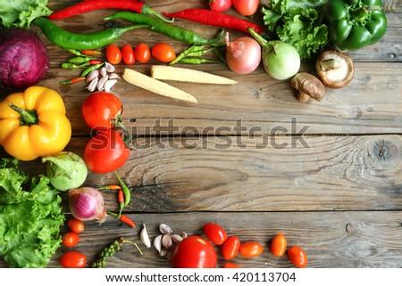Include vegetables on wooden floor #420113704