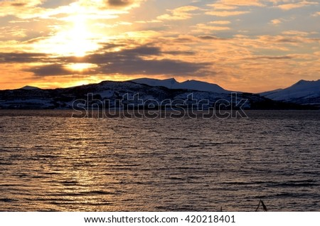 golden sunset sky over the Tromsoe city island #420218401