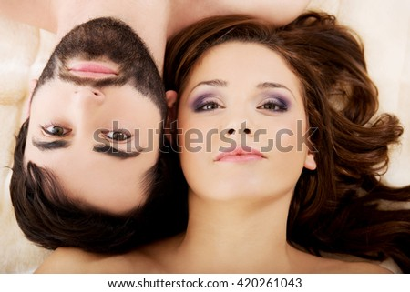 Relaxed young couple lying in bed. #420261043