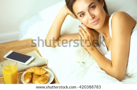 Young beautiful woman lying in bed #420388783