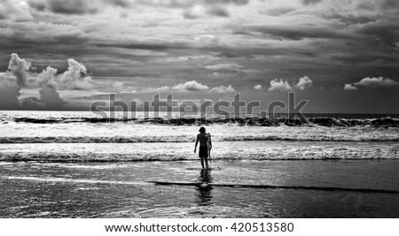 Men surfer and ocean. Black-white fine art photo.