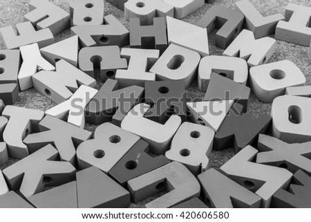 English alphabet wood  black  background #420606580