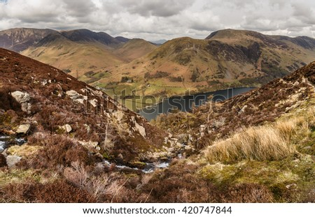 Buttermere, Lake District, as seen from the climb to High Stile. A small stream runs from the tarn to a waterfall #420747844