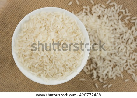 rice grain in white bowl on table. #420772468
