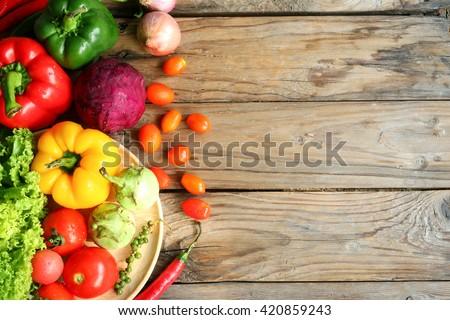 Include vegetables on wooden floor #420859243