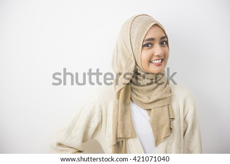 portrait of pretty oung asian muslim woman in head scarf smile #421071040
