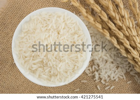 rice grain in white bowl on table. #421275541