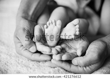 Children's feet in black white. The family #421276612
