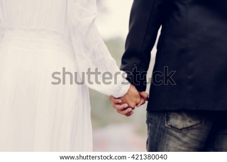 wedding couple blur people background #421380040