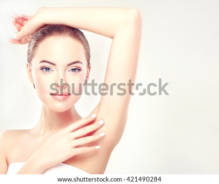 Armpit epilation, lacer hair removal. Young woman holding her arms up and showing clean underarms, depilation  smooth clear skin .Beauty portrait. Royalty-Free Stock Photo #421490284