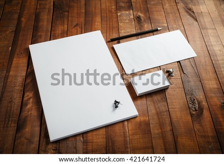 Blank stationery set on wooden table background. ID template. Mockup for branding identity for designers. Royalty-Free Stock Photo #421641724