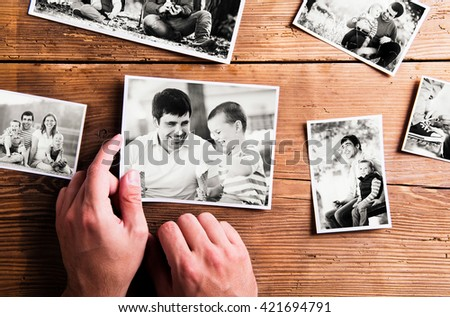 Fathers day composition. Black-and-white pictures, studio shot. Young father is enjoying time with his child. Father and son at home. Handsome father with little boy. Happy fathers day.