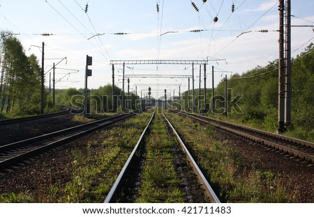 Railways and wires, one point perspective #421711483