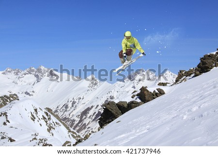 Ski rider jumping on mountains. Extreme ski freeride sport. #421737946