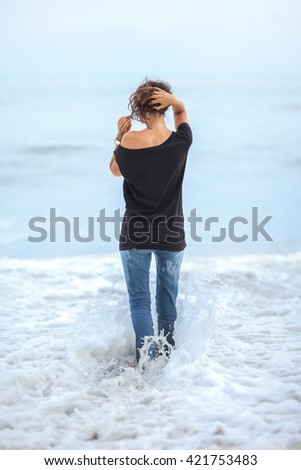 Alone beautiful woman standing in the sea during storm. Relax concept #421753483