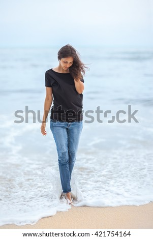 lonely beautiful woman walking on tropical beach. relax concept #421754164