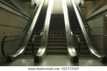 Automatic escalator in a train station                      #421772569
