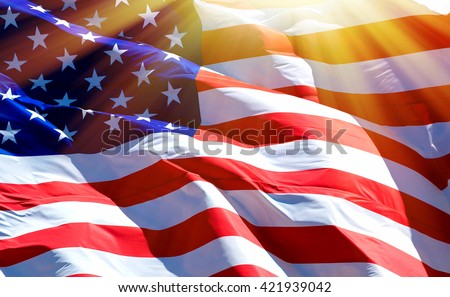 Flag of the USA with sunflare  Royalty-Free Stock Photo #421939042