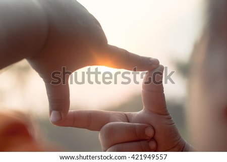 Hands make frame shape see Silhouette  beautiful sunset background.