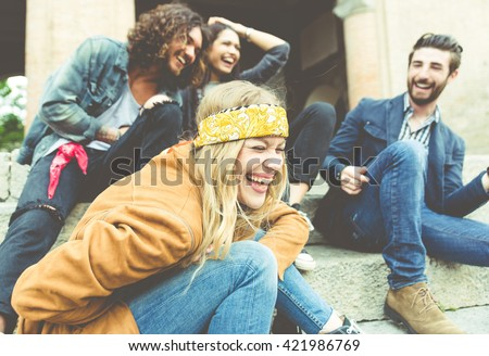 Group of four friends laughing out loud outdoor, sharing good and positive mood Royalty-Free Stock Photo #421986769