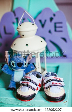 Little baby shoes and a toy #422052307
