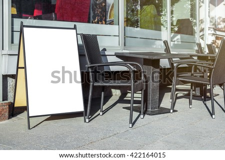 White mock up of blank cafe menu stand on a sidewalk