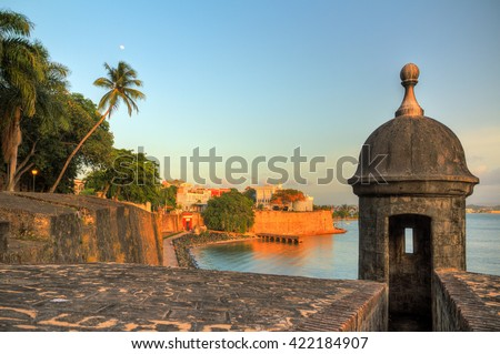 Beautiful summer afternoon at the outer wall with sentry box of fort San Felipe del Morro in old San Juan in Puerto Rico Royalty-Free Stock Photo #422184907