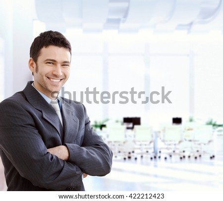 Happy smiling caucasian financial business expert standing at office lobby, arms crossed, looking at camera, copyspace, suit. #422212423