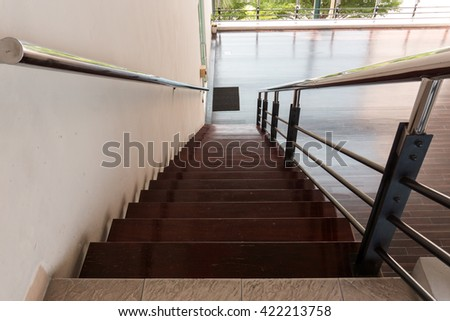 long wooden stairs with stainless railing #422213758