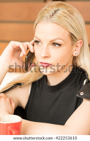 Attractive young business woman talking on mobile phone #422253610