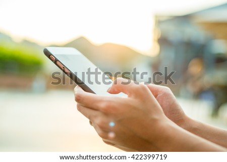 Woman using cellphone at outdoor #422399719