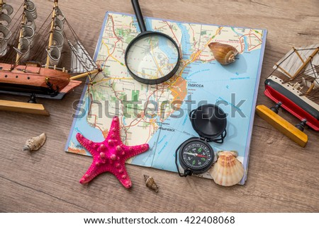 map, compass on seashell, ship on desk #422408068