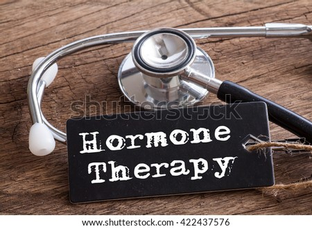 Stethoscope on wood with Hormone Therapy words as medical concept #422437576