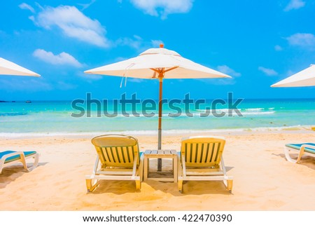 Beautiful tropical beach and sea landscape with coconut palm tree and umbrella and chair - Boost up color Processing #422470390