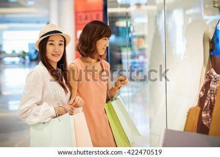 Cheerful friends standing in front of  showcase #422470519