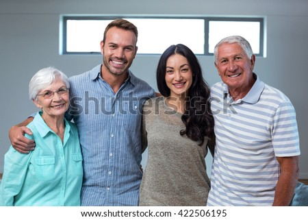Young couple with their grandparents in living room #422506195