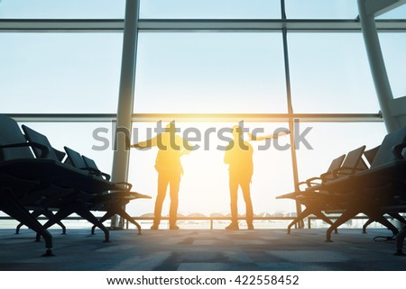 Two backpackers in hong kong airport #422558452