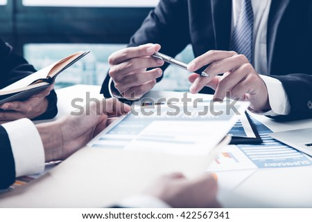 Group of business people busy discussing financial matter during meeting Royalty-Free Stock Photo #422567341