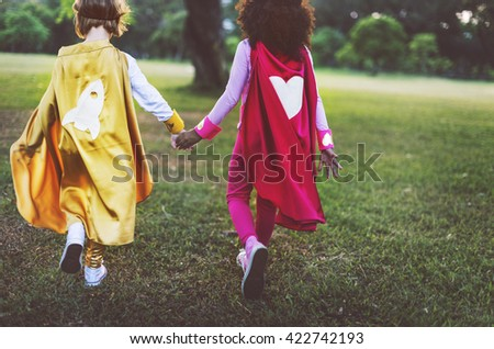 Superhero Girls Friendship Cute Happiness Fun Playful Concept Royalty-Free Stock Photo #422742193