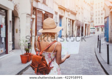 travel guide, tourism in Europe, woman tourist with map on the street Royalty-Free Stock Photo #422958991