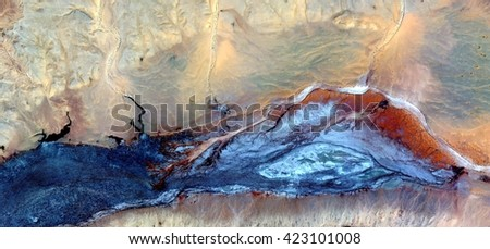 radioactive slug, abstract photography of the deserts of Africa from the air. aerial view of desert landscapes, Genre: Abstract Naturalism, from the abstract to the figurative, contemporary photo art