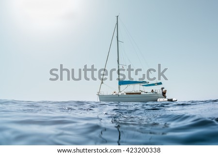 Sailing boat in a sea #423200338