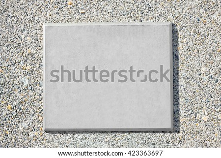 Blank metal plaque mounted on an old concrete wall. #423363697